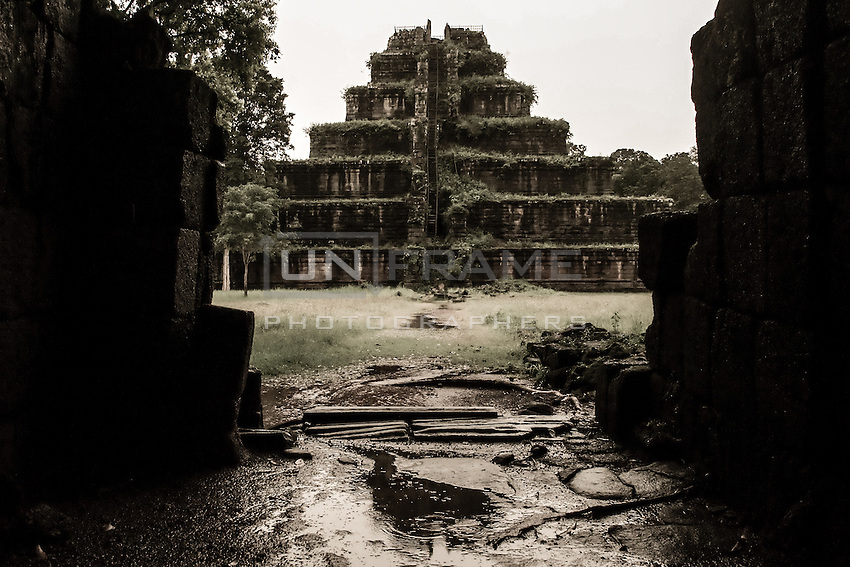 UNESCO World Heritage Site,  the once magnificint  pyramid of Ankgor Wat.  The future of the monumental complex relies on a very delicate and complex balance between preservation and intensive tourist exploitation.   Seam Reap, Cambodia.
