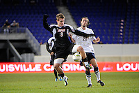 Colin Rolfe (9) of the Louisville Cardinals and Colin Bradley (20) of the Connecticut Huskies. Connecticut defeated Louisville 1-0 during the first semifinal match of the Big East Men's Soccer Championships at Red Bull Arena in Harrison, NJ, on November 11, 2011.