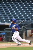 Josh Morgan #3 of the AZL Rangers bats against the AZL Cubs at Surprise Stadium on July 6, 2014 in Surprise, Arizona. (Larry Goren/Four Seam Images)