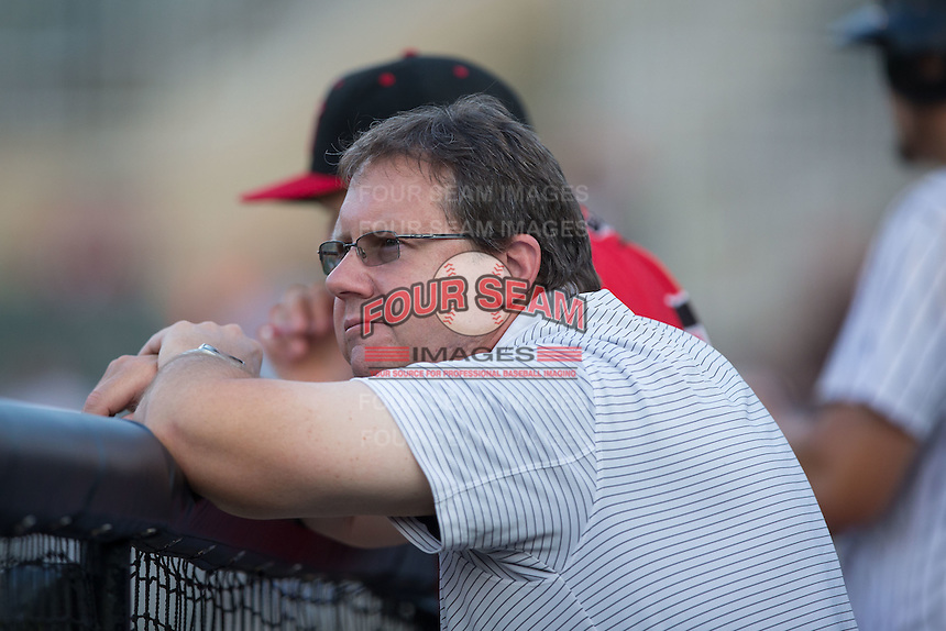 Kannapolis Intimidators trainer Joe Geck watches the action from the dugout during the game against the Asheville Tourists at Kannapolis Intimidators Stadium on May 26, 2016 in Kannapolis, North Carolina.  The Tourists defeated the Intimidators 9-6 in 11 innings.  (Brian Westerholt/Four Seam Images)
