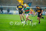 Shane Nolan of Crotta O'Neills surges ahead of Kevin Landers of Dr Crokes in the Senior County Hurling championship, round 2 game.