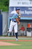 Asheville Hippies third baseman Jose Gomez (4) throws to first base during a game against the Greenville Drive at McCormick Field on June 29, 2017 in Asheville, North Carolina. The Drive defeated the Tourists 9-6. (Tony Farlow/Four Seam Images)