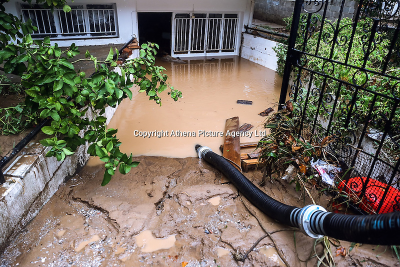 Emergency service pump water out from a flooded basement in Nea Mihaniona