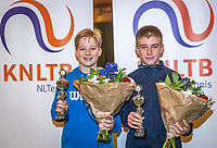 Wateringen, The Netherlands, December 15,  2019, De Rhijenhof , NOJK juniors doubles , Final boys 14 years, runners up Pieter de Lange (NED) and Manvydas Balciunas (NED) (R) with the trophy<br /> Photo: www.tennisimages.com/Henk Koster