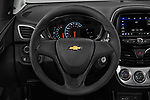 Car pictures of steering wheel view of a 2020 Chevrolet Spark LS Select Doors Door Hatchback