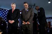 Tulsa, Oklahoma.USA.January 30, 2004..Presidential hopeful General Wesley Clark prays at a rally held at the Mount Zion Baptist Church.