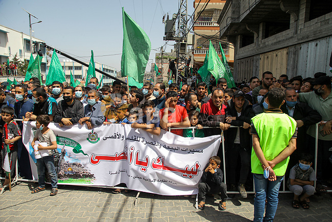Palestinian supporters of Hamas movement demonstrate against postponement of the Palestinian parliamentary and presidential elections, calling for holding elections on planned date in Jabalia in the nothern Gaza Strip on April 30, 2021. Palestinian President Mahmoud Abbas announced early Friday that the legislative elections scheduled for May 22 will be postponed until further notice. Photo by Mohammed Salem