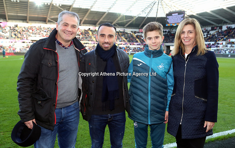 Leon Britton of Swansea City with Academy young payer during the Premier League match between Swansea City and Brighton and Hove Albion at The Liberty Stadium, Swansea, Wales, UK. Saturday 04 November 2017