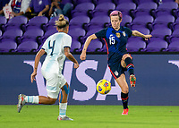 ORLANDO, FL - FEBRUARY 24: Megan Rapinoe #15 of the USWNT controls the ball during a game between Argentina and USWNT at Exploria Stadium on February 24, 2021 in Orlando, Florida.
