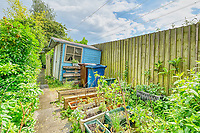 BNPS.co.uk (01202 558833)<br /> Pic: PropertyPublicity/BNPS<br /> <br /> Pictured: The garden<br /> <br /> Loco-cation, loco-cation, loco-cation..<br /> <br /> This quirky property that is up for sale is all about its loco-cation - as it sits on a railway crossing right next to the train tracks.<br /> <br /> The Grade II listed cottage was built in 1850 to house the gatekeeper whose job it was to close the gates at the road crossing whenever a train was due.<br /> <br /> The gates, in the village of Stone, Staffs, were automated many years ago.