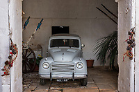 Italy. Apulia Region. Osturni. Masseria Brancati. A FIAT Giardinetta from 1964 is parked in a barn.  Within the ancient Apulian olive trees rises up one of the oldest masseria farmhouses, called Masseria Brancati, which dates back to the early Medieval period or even to the Roman one, which existence is evidenced by a very old underground olive mill. Fiat Automobiles S.p.A. (Fabbrica Italiana Automobili Torino) is an Italian automobile manufacturer. Apulia (Puglia) is a region in Southern Italy. 7.12.18  © 2018 Didier Ruef