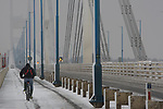 Closed to all vehicles because of snow a lone cyclist crosses the Severn Bridge.<br /> 13.01.10<br /> ©Steve Pope<br /> Sportingwales<br /> The Manor <br /> Coldra Woods<br /> Newport<br /> South Wales<br /> NP18 1HQ<br /> 07798 830089<br /> 01633 410450<br /> steve@sportingwales.com<br /> www.fotowales.com<br /> www.sportingwales.com<br /> ©Steve Pope<br /> Sportingwales<br /> The Manor <br /> Coldra Woods<br /> Newport<br /> South Wales<br /> NP18 1HQ<br /> 07798 830089<br /> 01633 410450<br /> steve@sportingwales.com<br /> www.fotowales.com<br /> www.sportingwales.com