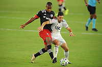 WASHINGTON, DC - AUGUST 25: Matt Polster #8 of New England Revolution battles for the ball with Ola Kamara #9 of D.C. United during a game between New England Revolution and D.C. United at Audi Field on August 25, 2020 in Washington, DC.