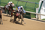 Llamarada with Sal Gonzalez Jr. (white cap) holds off Geniver and Miguel Mena (black cap) to win the 8th race at Churchill Downs. 05.22.2010