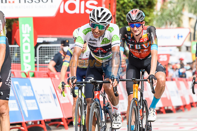 White Jersey Egan Bernal (COL) Ineos Grenadiers and Wout Poels (NED) Bahrain Victorious cross the finish line at the end of Stage 10 of La Vuelta d'Espana 2021, running 189km from Roquetas de Mar to Rincón de la Victoria, Spain. 24th August 2021.     <br /> Picture: Cxcling | Cyclefile<br /> <br /> All photos usage must carry mandatory copyright credit (© Cyclefile | Cxcling)