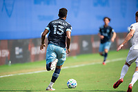 LAKE BUENA VISTA, FL - JULY 23: Derek Cornelius #13 of Vancouver Whitecaps FC dribbles the ball during a game between Chicago Fire and Vancouver Whitecaps at Wide World of Sports on July 23, 2020 in Lake Buena Vista, Florida.