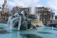 LONDON, ENGLAND - FEBRUARY 11: Cold temperatures have caused the fountains of Trafalgar Square to freeze on February 11, 2021 in London, England. Heavy snow brings a week of freezing temperatures across many parts of the UK and high winds of the South West coastal regions<br /> CAP/IH<br /> ©Ivan Harris/Capital Pictures
