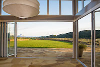 Sliding glass doors framing view into garden lawn, Shafer Vineyard, Napa, California