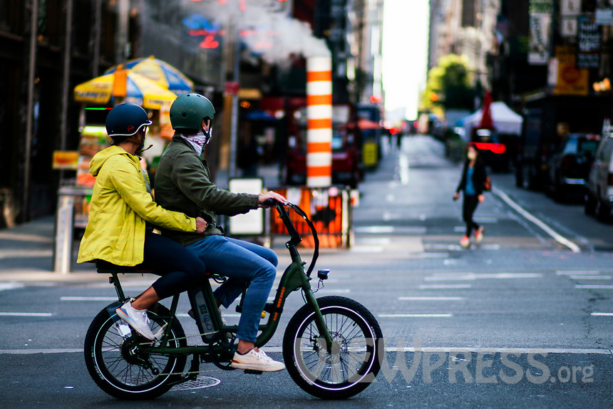 NEW YORK, NY - OCTOBER 15:  People  ride a bike at Times Square on October 15, 2020 in New York, At least 4,477 bicycles have been reported stolen with an increase of 27 percent from same period last year, according to the police. (Photo by Eduardo MunozAlvarez/VIEWpress)