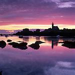 France, Brittany, near Brignogan Plage: Pointe de Pontusval lighthouse at dawn