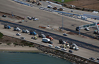 aerial photograph dump trucks during construction San Francisco Oakland Bay Bridge