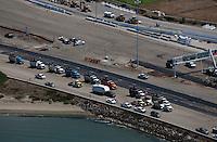aerial photograph dump trucks during construction San Francisco Oakland Bay Bridge