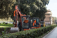 """Road workers: allowed.<br /> <br /> Rome, 12/03/2020. Documenting Rome under the Italian Government lockdown for the Outbreak of the Coronavirus (SARS-CoV-2 - COVID-19) in Italy. On the evening of the 11 March 2020, the Italian Prime Minister, Giuseppe Conte, signed the March 11th Decree Law """"Step 4 Consolidation of 1 single Protection Zone for the entire national territory"""" (1.). The further urgent measures were taken """"in order to counter and contain the spread of the COVID-19 virus"""" on the same day when the WHO (World Health Organization, OMS in Italian) declared the coronavirus COVID-19 as a pandemic (2.).<br /> ISTAT (Italian Institute of Statistics) estimates that in Italy there are 50,724 homeless people. In Rome, around 20,000 people in fragile condition have asked for support. Moreover, there are 40,000 people who live in a state of housing emergency in Rome's municipality.<br /> March 11th Decree Law (1.): «[…] Retail commercial activities are suspended, with the exception of the food and basic necessities activities […] Newsagents, tobacconists, pharmacies and parapharmacies remain open. In any case, the interpersonal safety distance of one meter must be guaranteed. The activities of catering services (including bars, pubs, restaurants, ice cream shops, patisseries) are suspended […] Banking, financial and insurance services as well as the agricultural, livestock and agri-food processing sector, including the supply chains that supply goods and services, are guaranteed, […] The President of the Region can arrange the programming of the service provided by local public transport companies […]».<br /> Updates: on the 12.03.20 (6:00PM) in Italy there 14.955 positive cases; 1,439 patients have recovered; 1,266 died.<br /> <br /> Footnotes & Links:<br /> Info about COVID-19 in Italy: http://bit.do/fzRVu (ITA) - http://bit.do/fzRV5 (ENG)<br /> 1. March 11th Decree Law http://bit.do/fzREX (ITA) - http://bit.do/fzRFz (ENG)<br /> 2. http://bit.do/fzRKm"""
