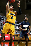 SIOUX FALLS, SD - MARCH 9: Dezmond McKinney #0 of the North Dakota State Bison lays the ball up past Max Abmas #3 of the Oral Roberts Golden Eagles during the 2021 Men's Summit League Basketball Championship at the Sanford Pentagon in Sioux Falls, SD. (Photo by Dave Eggen/Inertia)