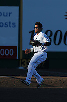 Corey Simpson #36 of the Everett AquaSox chases after a foul fly ball during a game against the Tri-City Dust Devils at Everett Memorial Stadium on July 29, 2014 in Everett, Washington. Everett defeated Tri-City, 7-5. (Larry Goren/Four Seam Images)