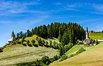 Italy, South Tyrol (Trentino - Alto Adige), La Valle: hamlet Tolpei with steeple of parish church St Genesius in Old-Wengen (right), the chapel Saint Barbara (left) | Italien, Suedtirol (Trentino - Alto Adige), Wengen: der Weiler Tolpei mit dem Turm der alten Pfarrkirche St. Genesius in Altwengen (rechts) und links die spaetgotische Barbarakapelle