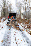 Wisconsin deer hunter using a winch to load a white-tailed buck onto a trailer.