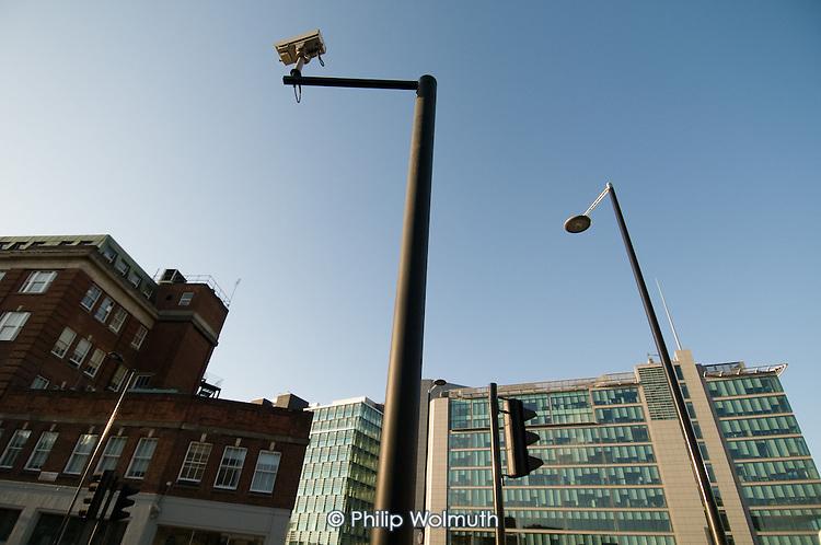 Surveillance camera on a high pole close the Paddington Central office and retail development and Paddington station, London