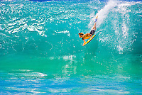A bodyboarder takes on the large, barreling shorebreak wave at Ke Iki Beach, on the North Shore of Oahu.