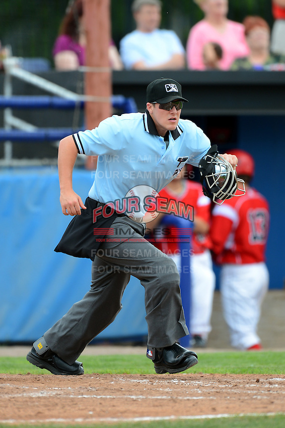 Home plate umpire Brennan Miller during a NYPL game between the Batavia Muckdogs and State College Spikes on June 30, 2013 at Dwyer Stadium in Batavia, New York.  State College defeated Batavia 7-2.  (Mike Janes/Four Seam Images)
