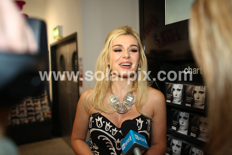 """**ALL ROUND PICTURES FROM SOLARPIX.COM**.**WORLDWIDE SYNDICATION RIGHTS**.British Classical singer Katherine Jenkins launches her new album """"Believe """" at the HMV record store in Birmingham Uk...This pic:Katherine Jenkins..JOB REF: 10203      NYA     DATE:28.10.09.**MUST CREDIT SOLARPIX.COM OR DOUBLE FEE WILL BE CHARGED**.**MUST NOTIFY SOLARPIX OF ONLINE USAGE**.**CALL US ON: +34 952 811 768 or LOW RATE FROM UK 0844 617 7637**"""