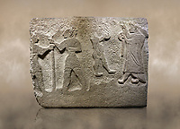 Alaca Hoyuk Hittite monumental relief sculpted orthostat stone panel. Andesite, Alaca, Corum, 1399 - 1301 B.C. Anatolian Civilizations Museum, Ankara, Turkey<br /> <br /> The rightmost figure wears a long coat and tailed dress. With both hands, he holds a sceptre with a ring in the middle. This item is thought to be a cult object in Assyria reliefs. The pointed and twisted tips of his shoes also show that he is in a high rank.  <br /> <br /> Against a brown art background.