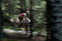 Riding fast through the forest. Grenserittet is a 80km mountain bike race starting in the Swedish town of Strömstad, ending up in the Norwegian town Halden. The interest for these kind of bike races has exploded in Norway the last few years, particularly with middle age affluent men.