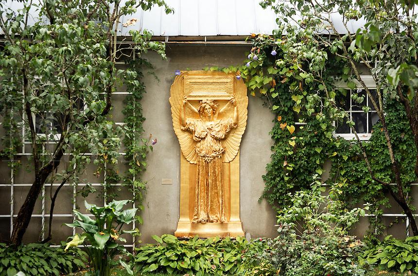 Golden relief of female angle in garden setting, New Gallery atrium, Saint-Gaudens National Historic Site, Cornish, Sullivan County, New Hampshire, US