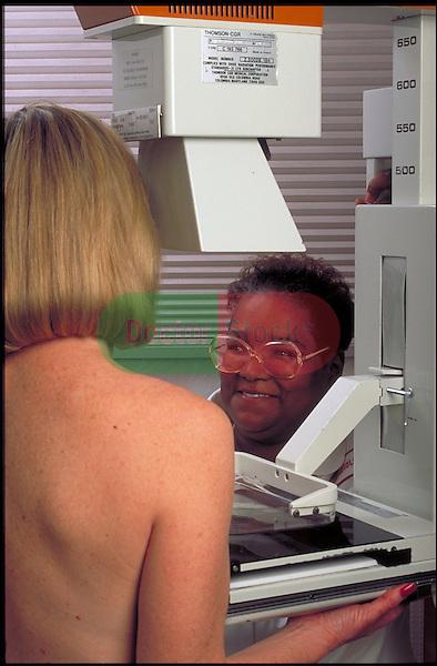 woman having mammogram done