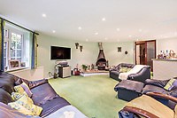 BNPS.co.uk (01202 558833)<br /> Pic: KnightFrank/BNPS<br /> <br /> Pictured: Lounge room.<br /> <br /> An impressive family home built in an 'industrial scale' oast house with multiple circular rooms is on the market for £1.6m.<br /> <br /> The property is one half of a massive former six roundel oast house that has been expanded and renovated by the current owners.<br /> <br /> Estate agents Knight Frank say the roundels are far larger than normally seen in most oast houses, which means the property has quirky character while also being a practical family home.<br /> <br /> This six-bedroom house is in the picturesque Kent countryside, but just 1.5 miles from the village of Hadlow and ten minutes' drive from the bigger town of Tonbridge.