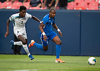 DENVER, CO - JUNE 19: Erick Rizo #3 and Kevin Fortune #9 go after the ball during a game between Martinique and Cuba at Broncos Stadium on June 19, 2019 in Denver, Colorado.
