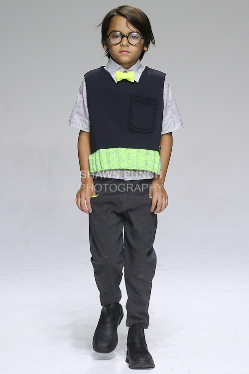 Young model walks runway in an outfit from the Parsons childrenswear Spring Summer 2015 collection, at petitePARADE Spring Summer 2015, during Kids Fashion Week in New York City, on October 18, 2014.