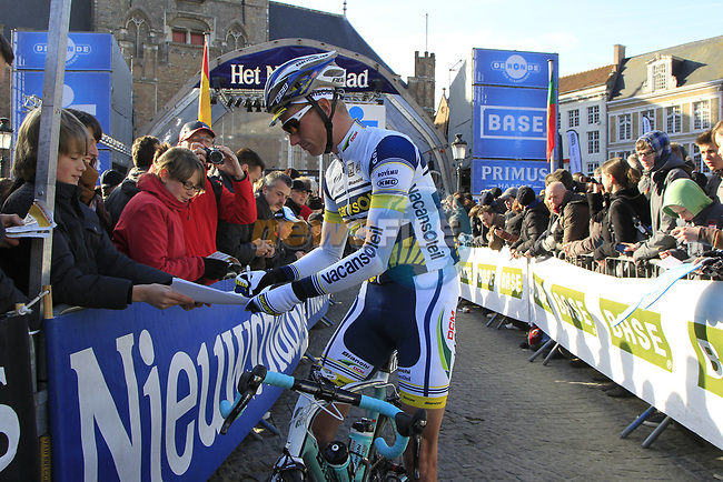 Vacansoleil-DCM Pro Cycling Team rider Lieuwe Westra (NED) signs autographs before the start of the 96th edition of The Tour of Flanders 2012 in Bruges Market Square, running 256.9km from Bruges to Oudenaarde, Belgium. 1st April 2012. <br /> (Photo by Eoin Clarke/NEWSFILE).
