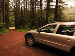 Volvo XC70 Car on an unpaved road in a stormy misty weather the nature Image © MaximImages, License at https://www.maximimages.com