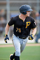 Pittsburgh Pirates catcher Arden Pabst (75) runs to first base during a Florida Instructional League game against the Toronto Blue Jays on September 20, 2018 at the Englebert Complex in Dunedin, Florida.  (Mike Janes/Four Seam Images)