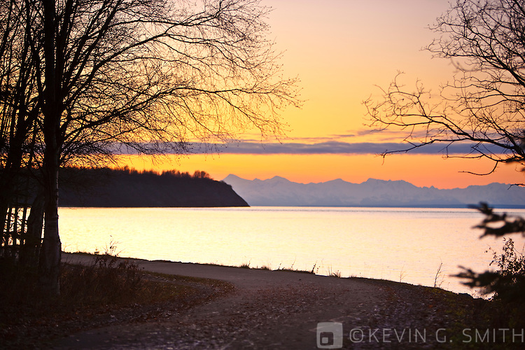 The Tony Knowles Coastal Trail at sunset, view looking East towards Point Woronzof and the Alaska Range, Anchorage, Southcentral Alaska, USA.