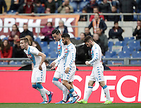 Napoli's Dries Mertens, right, celebrates with teammates, from left, Marko Rog, Jose' Maria Callejon and Lorenzo Insigne after scoring his first goal as Roma's goalkeeper Wojciech Szczesny tries to stop him during the Italian Serie A football match between Roma and Napoli at Rome's Olympic stadium, 4 March 2017. <br /> UPDATE IMAGES PRESS/Isabella Bonotto