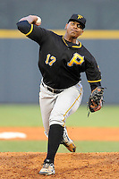 Pitcher Miguel Ferreras (17) of the Bristol Pirates delivers a pitch in a game against the Greeneville Astros on Friday, July 25, 2014, at Pioneer Park in Greeneville, Tennessee. Greeneville won, 9-4. (Tom Priddy/Four Seam Images)