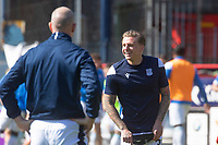 24th April 2021; Dens Park, Dundee, Scotland; Scottish Championship Football, Dundee FC versus Raith Rovers; Jason Cummings of Dundee laughs during the warm up before the match