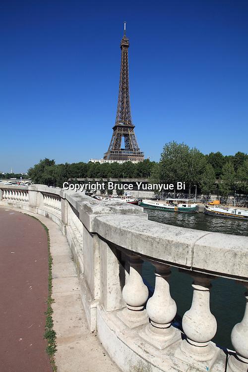 The view of Eiffel Tower la tour eiffel with River Seine in froreground. City of Paris. Paris. France